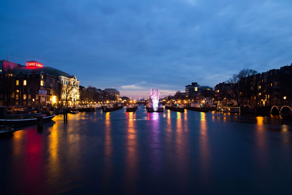 How to spend 3 days in Amsterdam: view of the Amstel river and Carre theater during Light Festival