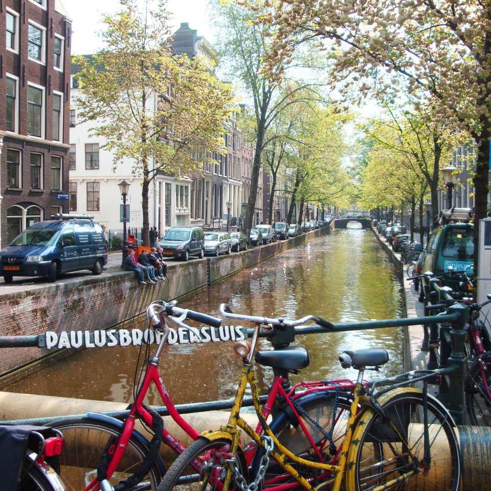 Bikes parked next to a canal in Amsterdam: 3 days in Amsterdam itinerary