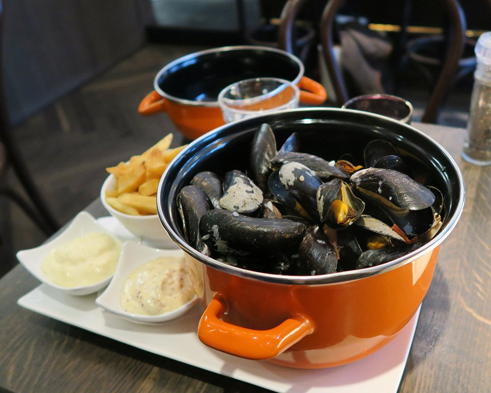 Eating mussels in Maastricht, Complete city guide to Maastricht with things to in Maastricht in 24 hours + Free Trip Planning Resources for The Netherlands!