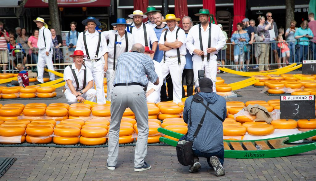 Cheese guild members posing for a photo on the cheese market Alkmaar in Netherlands