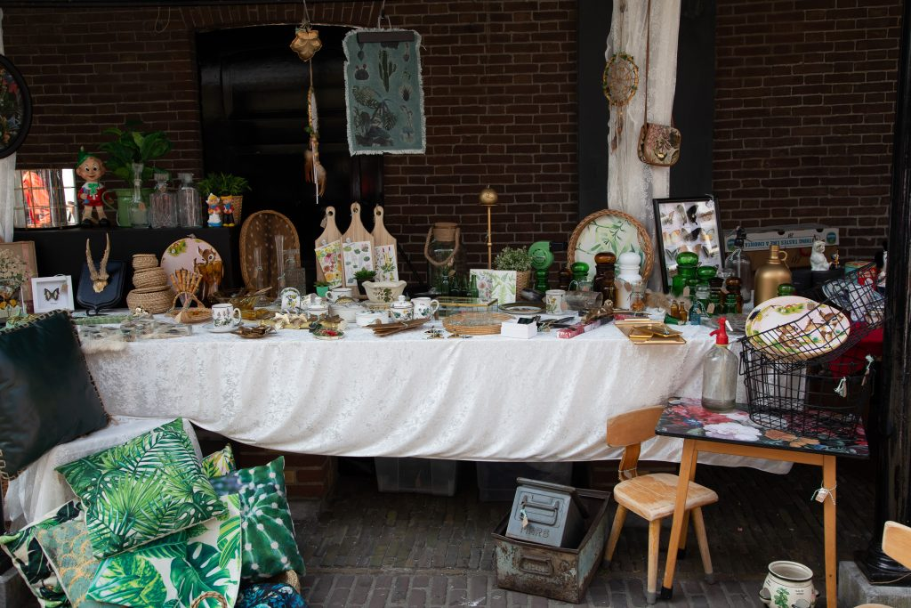Things to do in Alkmaar Netherlands: Shopping a stall filled with interior items sold outdoors
