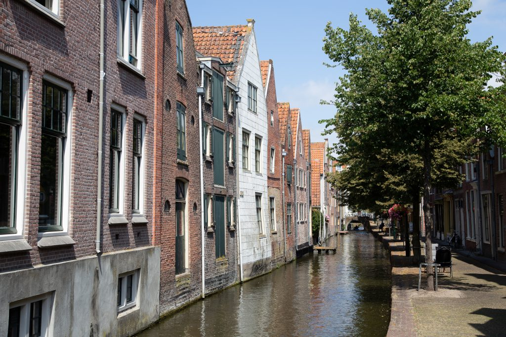 View on one of Alkmaar's streets with house fronts next to a narrow canal