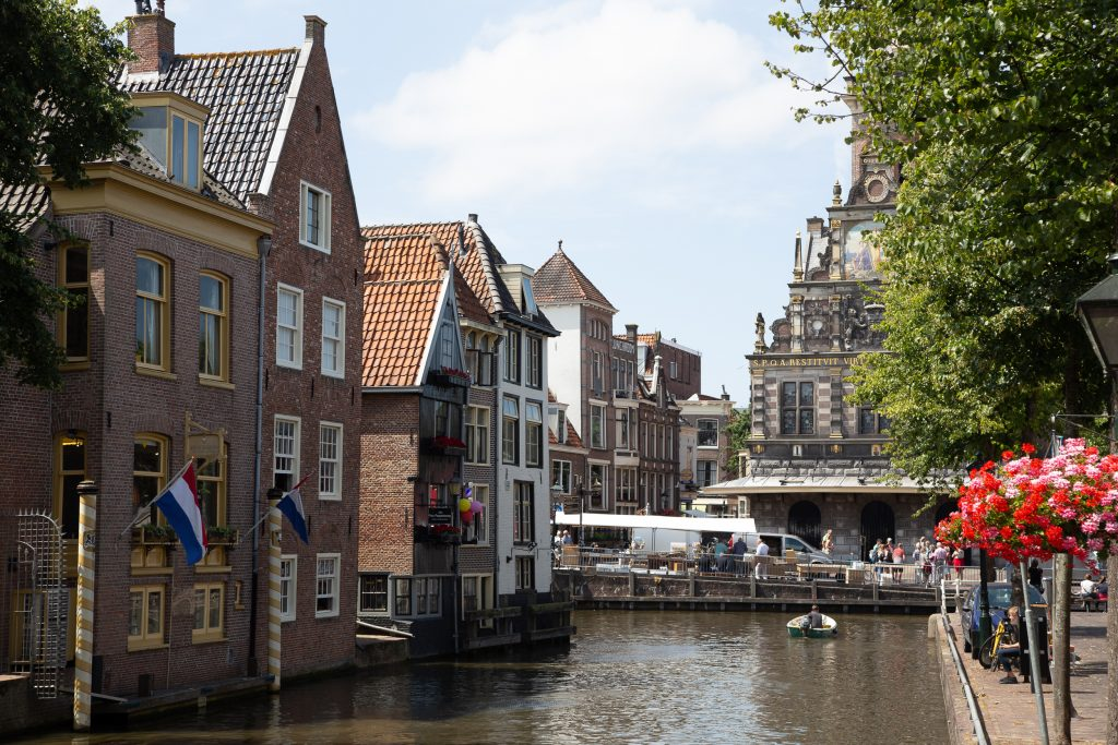 View on one of the water canals in Alkmaar with the view on the Waag