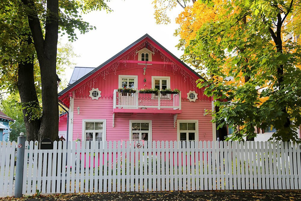 Pink wooden house in Tallinn Estonia during autumn