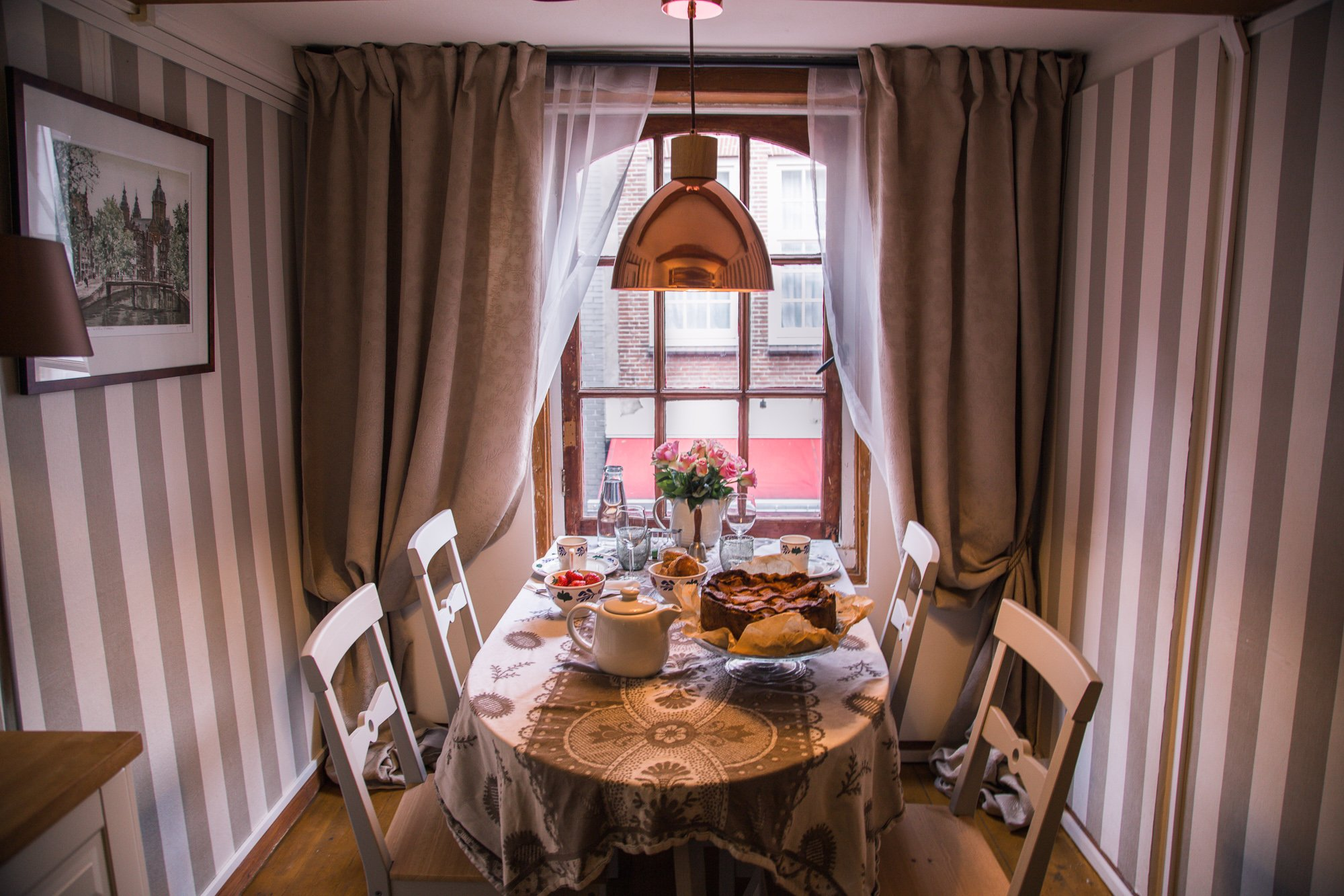 Unique things to do in Amsterdam: have high tea at the smallest house in Amsterdam