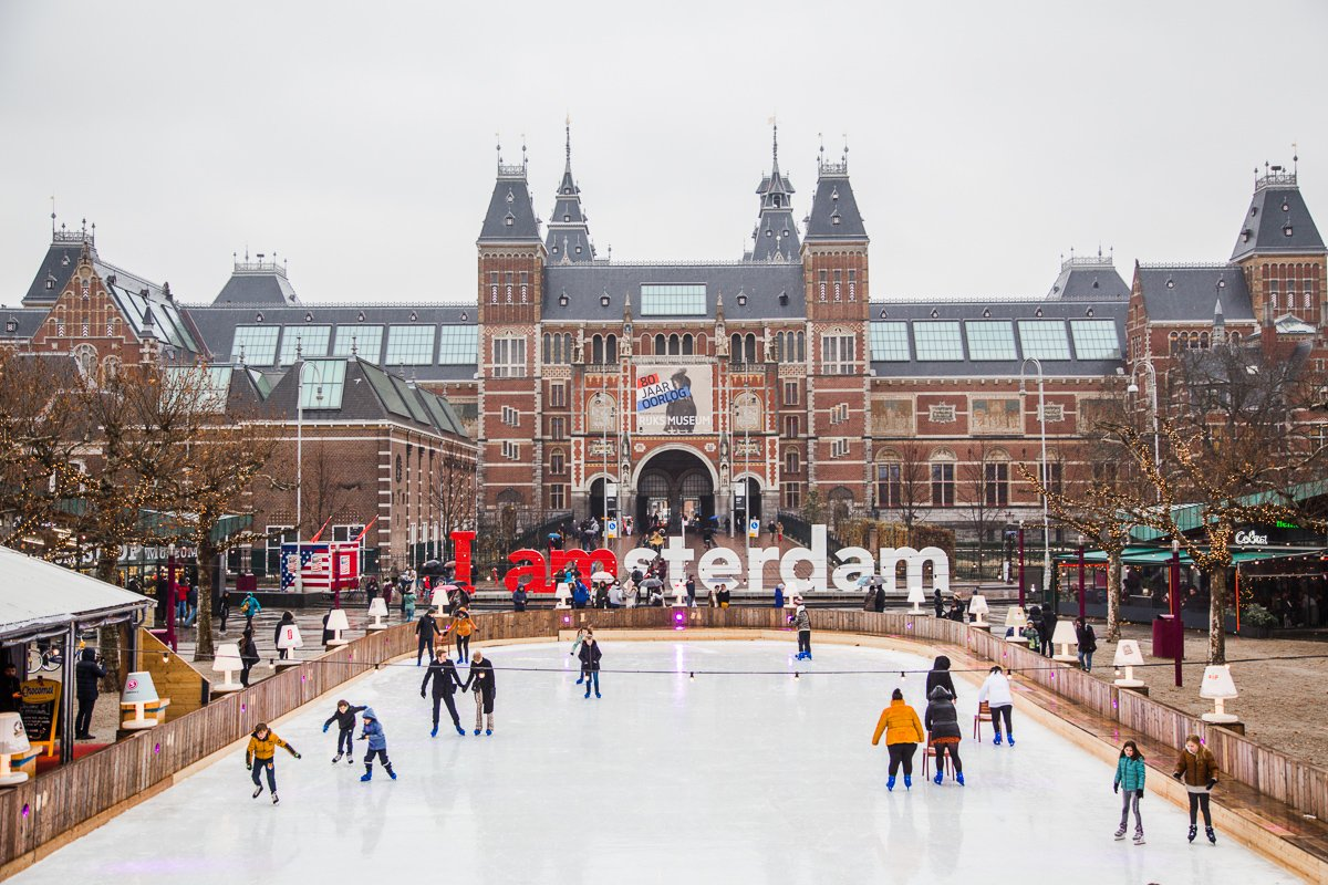 Things To Do In Amsterdam In December: Ice skating on Museumplein in winter in Amsterdam