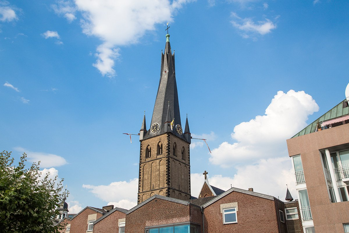 What to do in Dusseldorf Germany in a day: visit Basilica St. Lambertus which has a long black spire with a cross on top