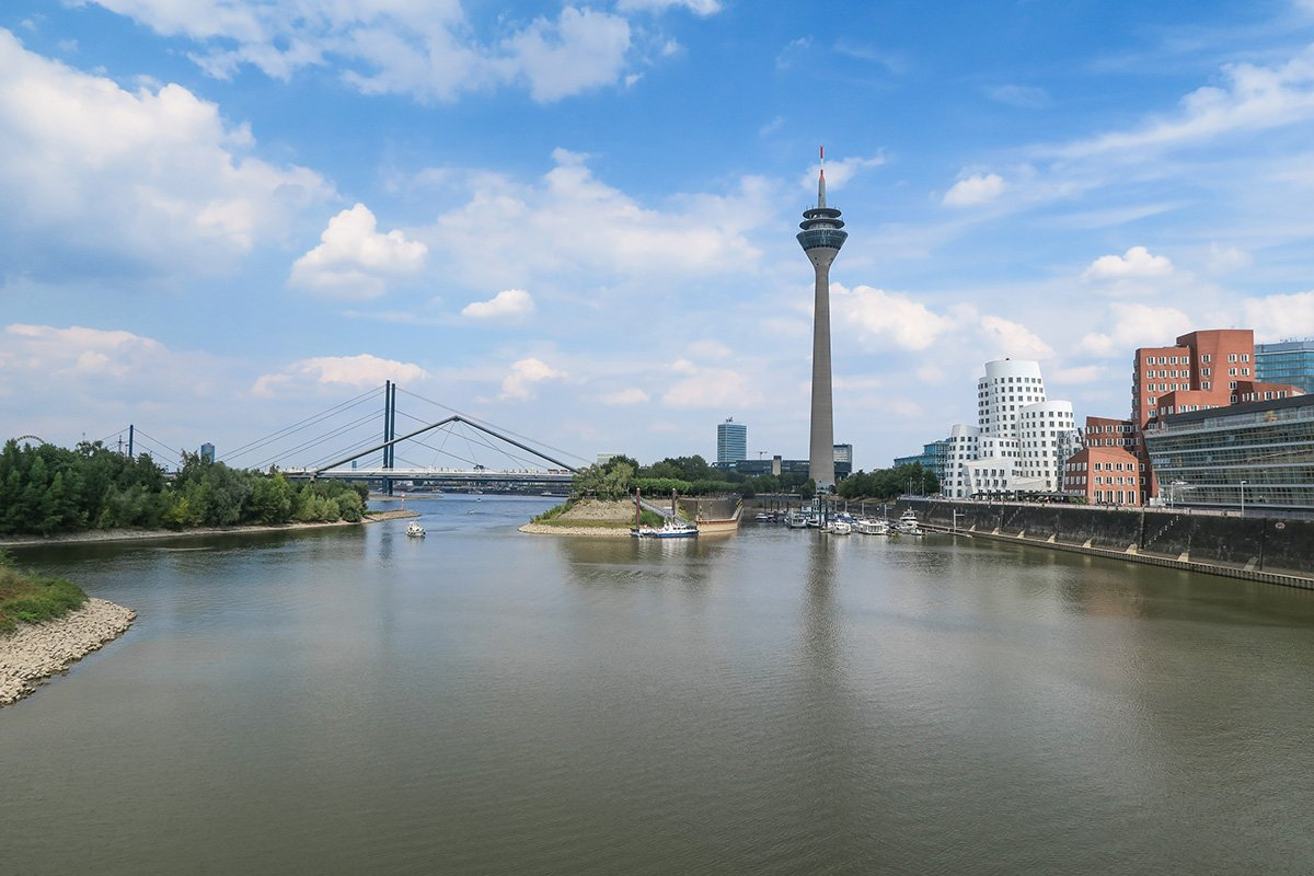 View on the Rheinturm or Rhein Tower next to the Medienhafen in Dusseldorf Germany
