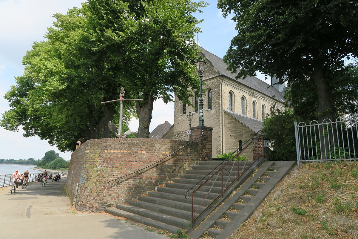 View on the promenade of Düsseldorf Kaiserswerth with a staircase leading towards the local church