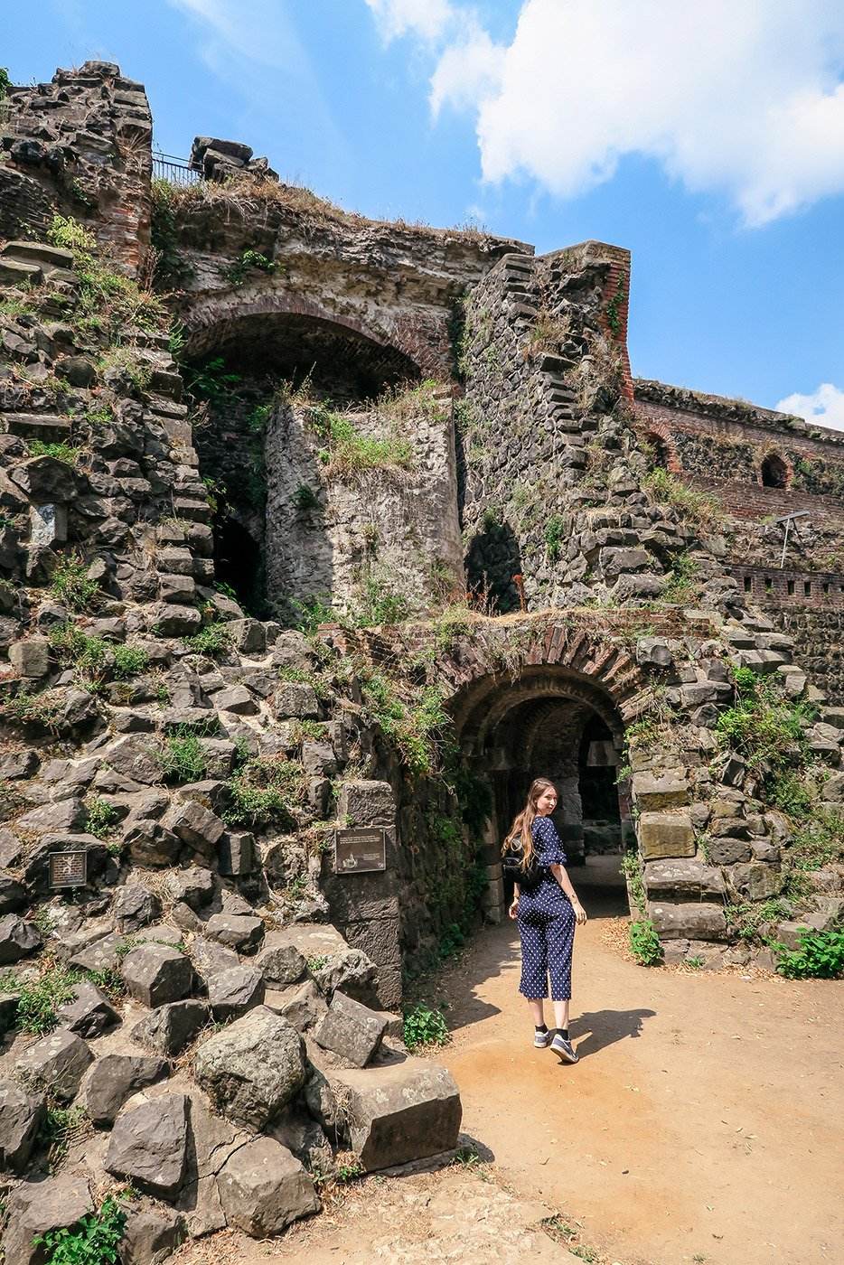 Kaiserpfalz ruins with a girl standing in front of the gate at Düsseldorf Kaiserswerth