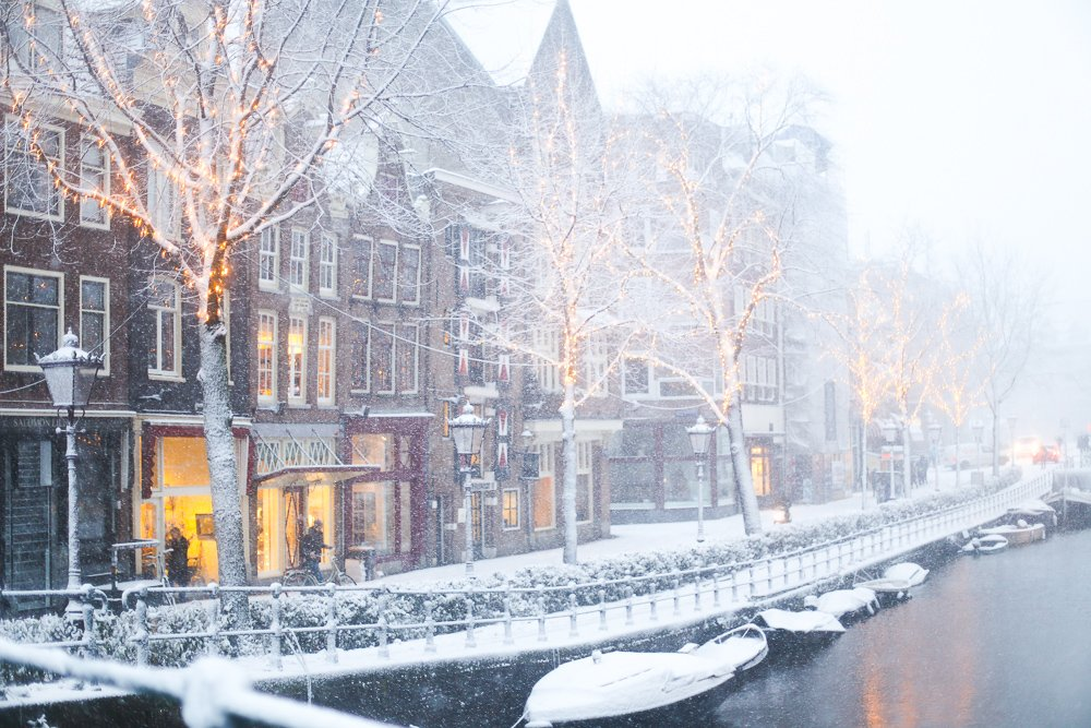 Amsterdam canals covered in snow and illumination