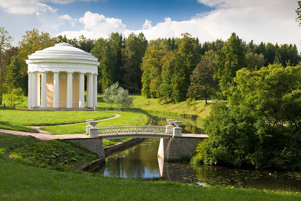 Temple of Friendship in Pavlovsk Park - Small round structure by the bridge in a green forest park