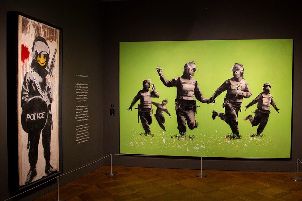 Banksy cops in the field art in Moco Museum