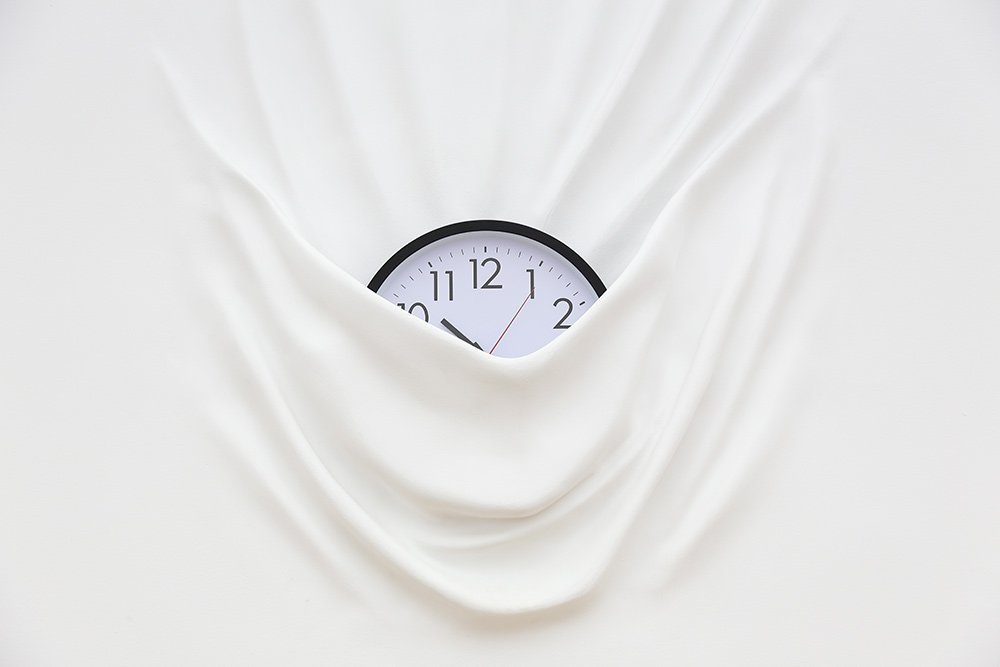 Daniel Arsham artwork clock within a white wall