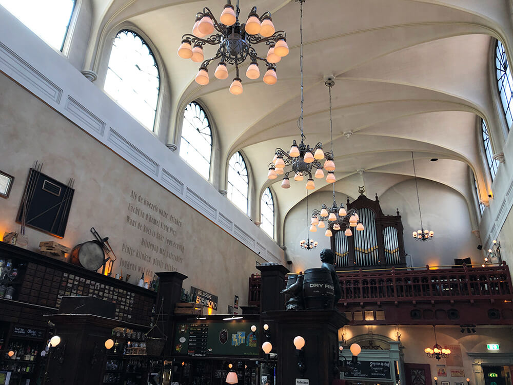 Old church turned beer cafe Olivier in Utrecht with high vaulted ceilings