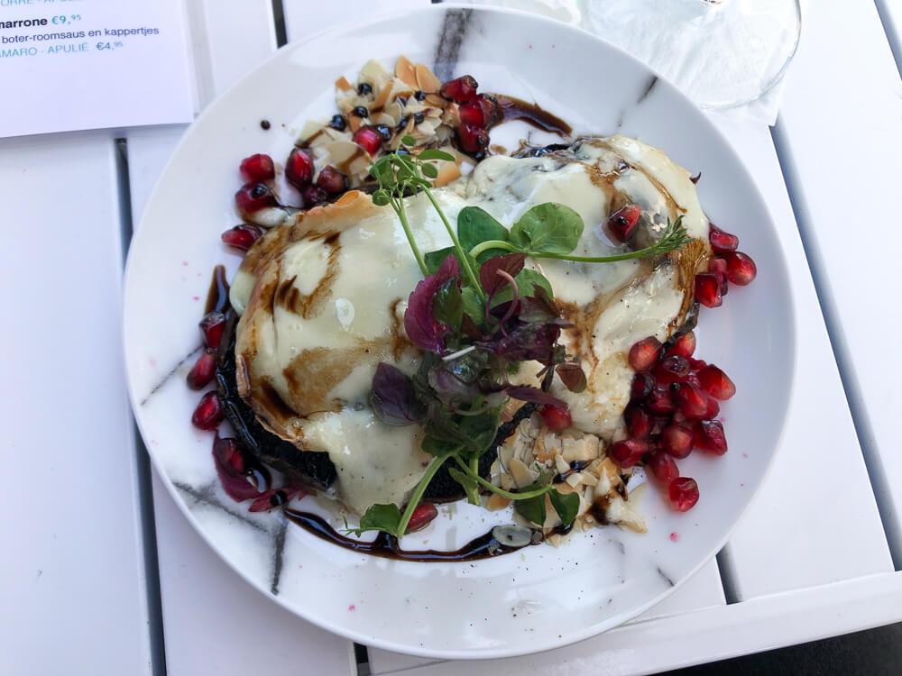 Portobello mushrooms with cheese and pomegranate at Piatto Utrecht